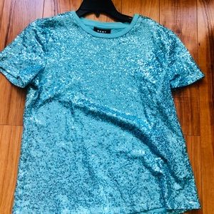 Turquoise sequined T-shirt by DKNY.
